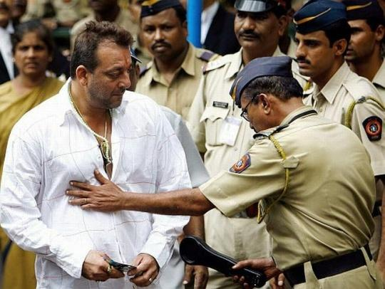 Sanjay Dutt frisked by a policeman