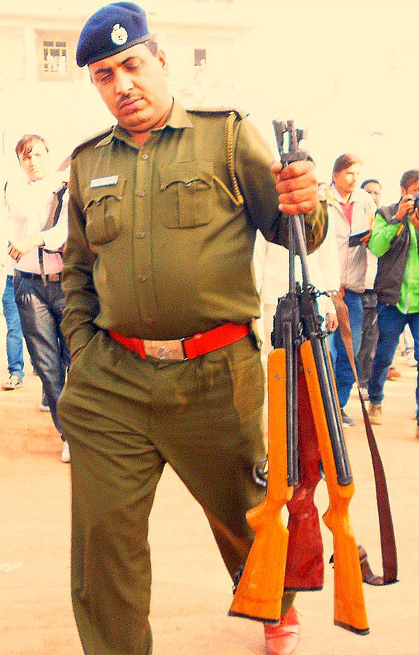 Police with guns from the satlok ashram