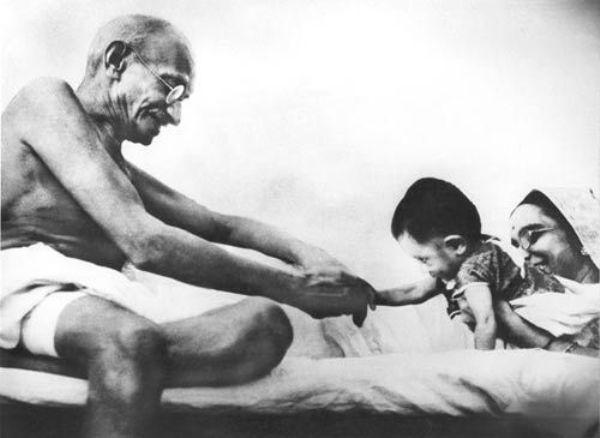 Gandhi playing with a kid