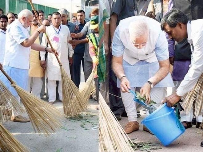 Narendra Modi taking part in Swacch Bharat campaign