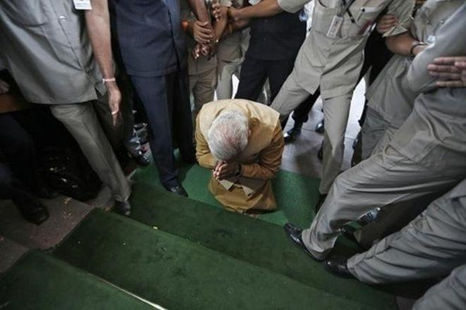 Narendra Modi bowing his head at the Parliament's entrance