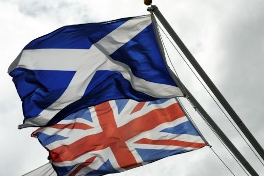 The Saltire, the flag of Scotland flies above the Union flag