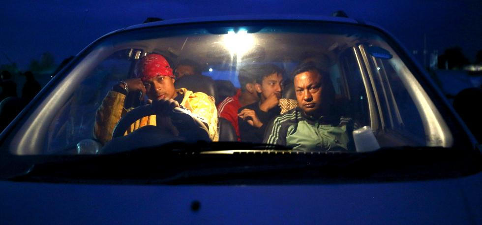 Nepal people waiting in card. Image: Reuters