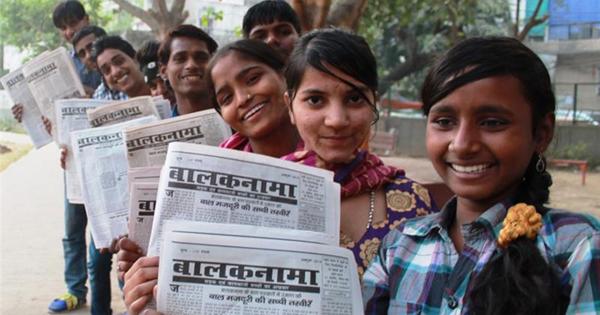 Kids holding the Balaknama newspaper