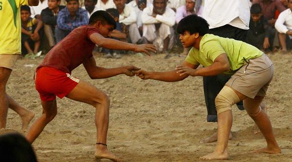 Divya wrestles a male opponent