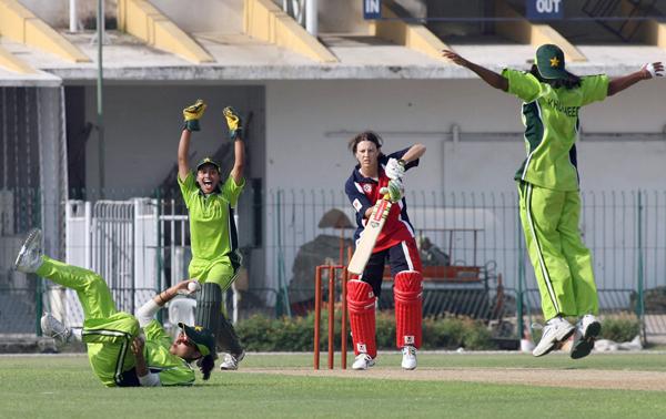 Khurjeed Jabeen (celebrating on right)