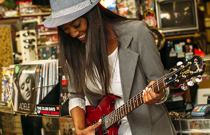 Women Playing Guitar