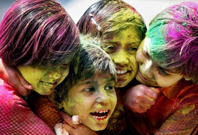 kids playing holi