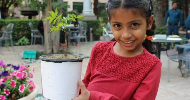 Child with sapling