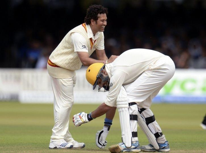 Image result for cricketers who has touched Tendulkar feet
