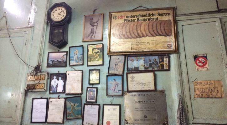 wall with advertisements and posters from the 50s