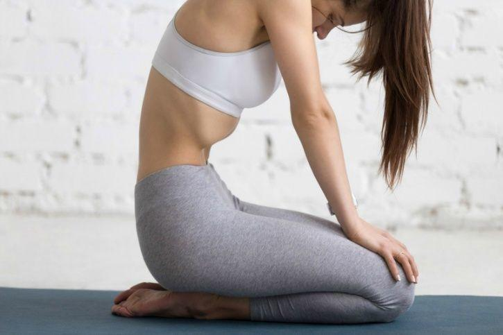 Perform seated vacuums to burn belly fat and improve your posture
