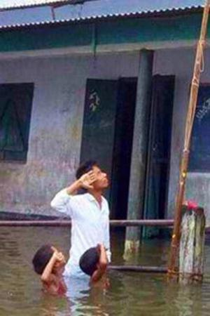 Boy Who Saluted National Flag Half Submerged In Water Fails To Find Place In NRC