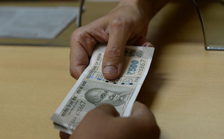 rupees at 71