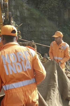 Rescuers scuba divers Meghalaya miners K Sangma coal mining NGT
