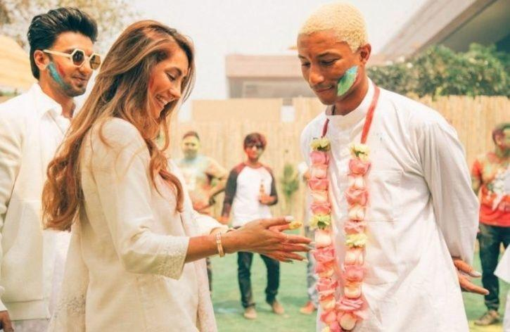 81114c283894e Pharrell Williams Looked Anything But  Happy  While Playing Holi In ...