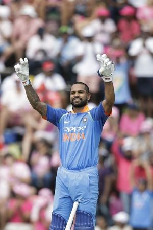 Shikhar Dhawan spreads his arms in his signature style
