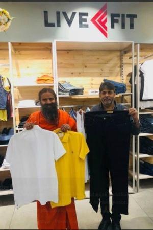 Baba Ramdev sanskaari ripped jeans Patanjali saffron langot Delhi