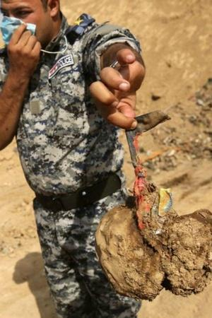ISIS mass grave sites Mosul Iraq rape violence United Nations bodies