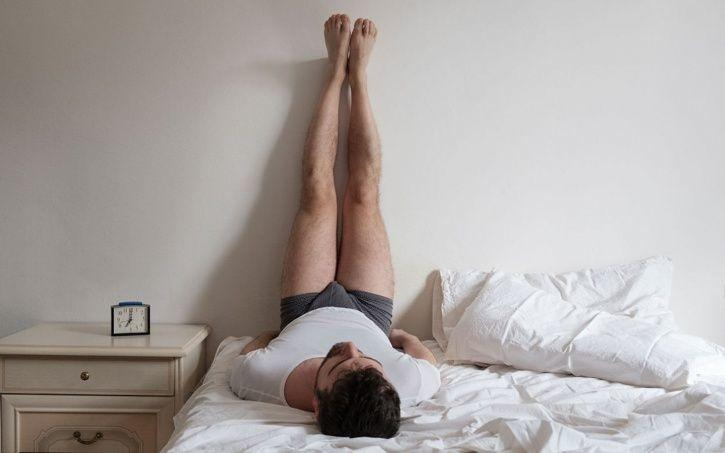 Lying Down With Your Legs Up Against The Wall Is The Most Beneficially Relaxing Yoga Posture