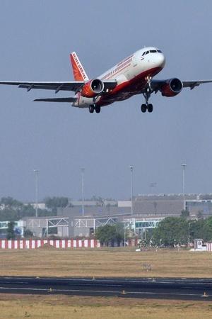 Mumbai airport passengers Air India strike contractual employees spokesperson