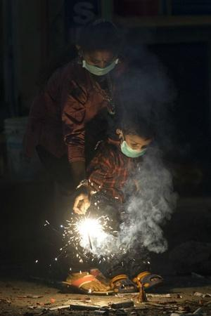 People Wearing Protective Masks Bursting Crackers