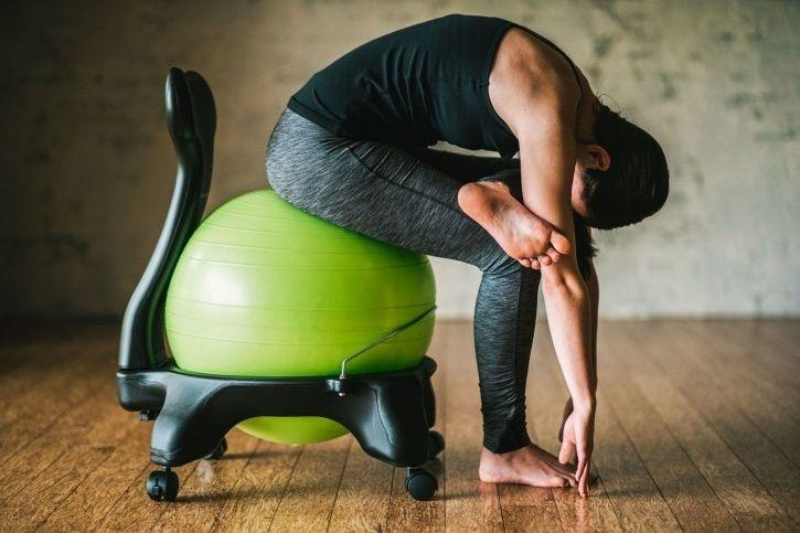 9 Yoga Stretches You Can Perform At Your Office Desk
