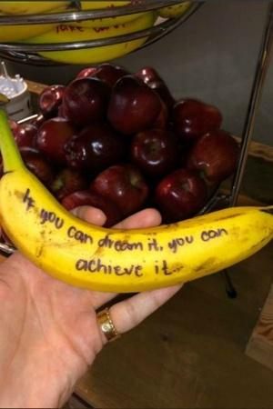 banana banana wisdom hotel writes inspirational messages on bananas hampton inn austin
