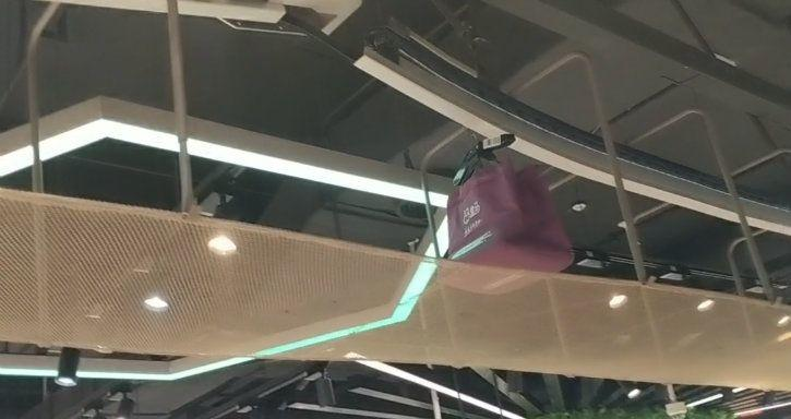 hema shopping bags ceiling conveyor belt