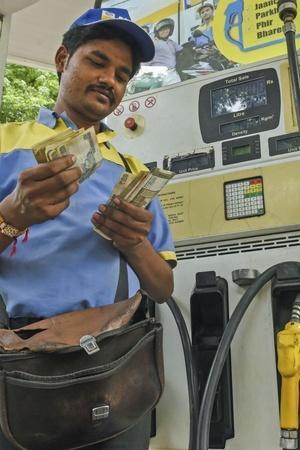 Petrol price diesel price opposition New Delhi global crude oil US dollar