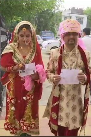 Lok Sabha elections Jammu and Kashmir Udhampur bride groom voting elderly couple