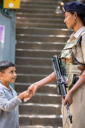 an adorable photo of a CRPF Central Reserve Police Force personnel shaking hands with a Kashmiri k