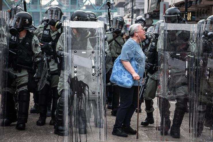 An old woman confronts Hong Kong Police.