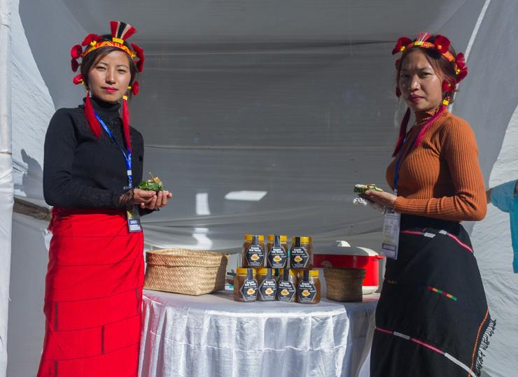 Two Shoixe ladies of Zunheboto district with honeycomb.