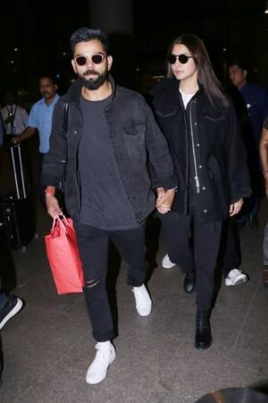Virat Kohli and Anushka Sharma return to Mumbai post celebrating Valentines Day in Delhi