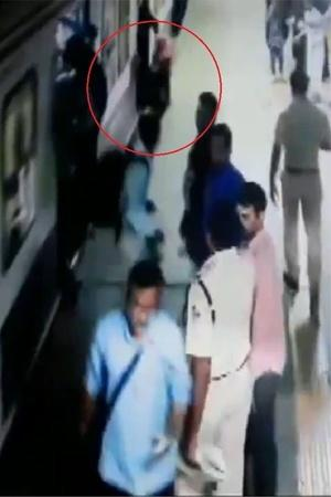 Woman saved train accident Malad railway station RPF officer woman saved from being crushed unde