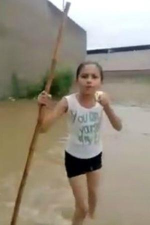 A school girls reporting on waterlogging