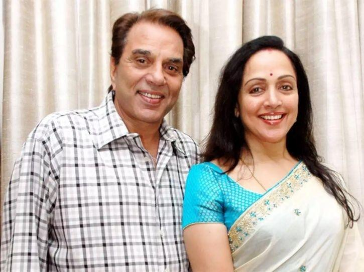 Dharmendra and Hema Malini after her sweeping act with a broom outside parliament.
