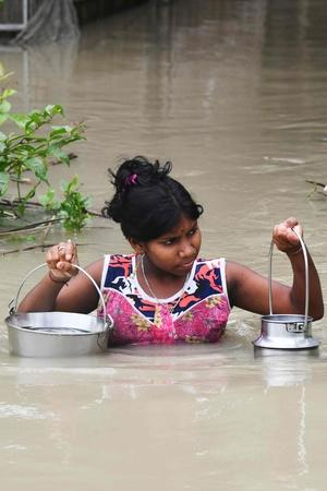 Flood Ravages Most Parts Of Assam And Bihar More Top News