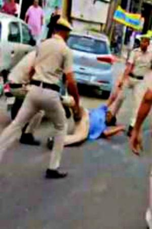 Delhi Police Brutally Thrashes Auto Driver Son Social Media Erupts In Anger