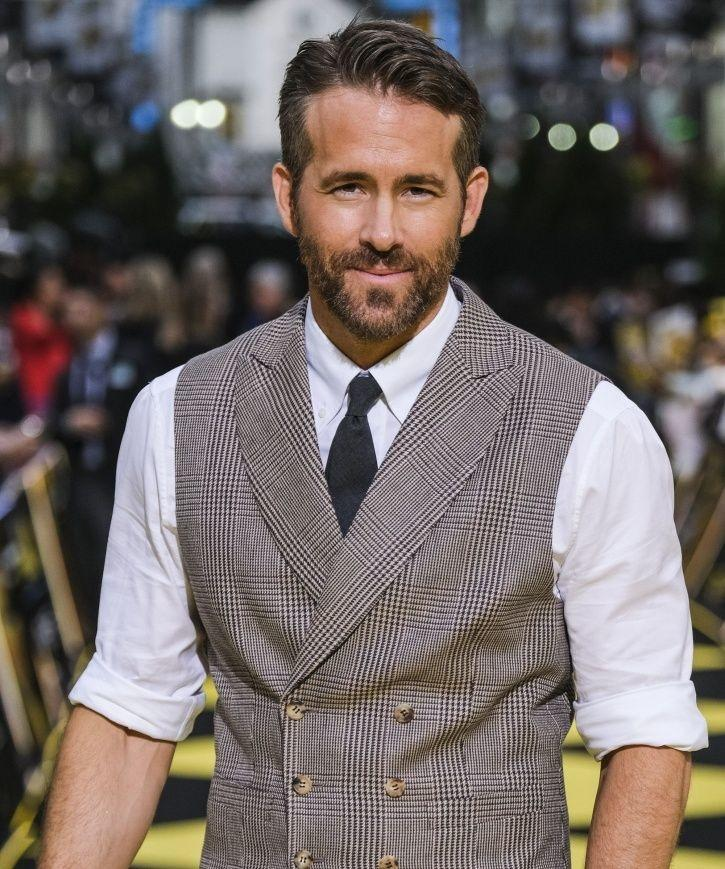 Just a photograph of Ryan Reynolds looking handsome with that smile.