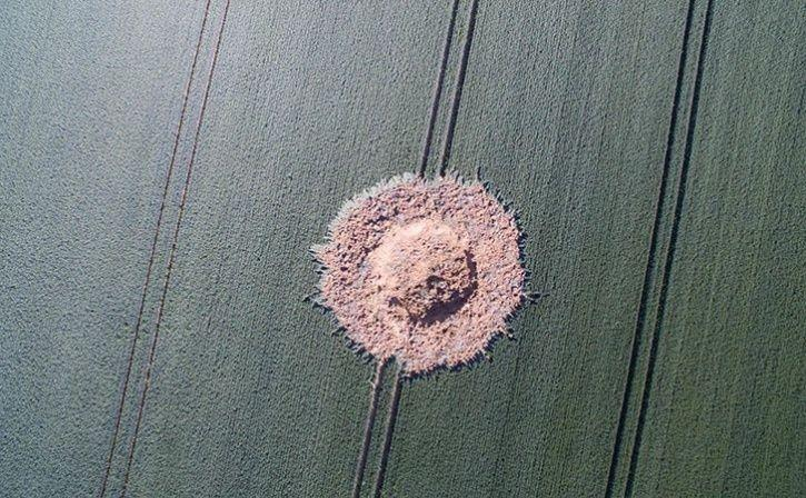 Suspected WWII Bomb Blast Causes Crater In German Field