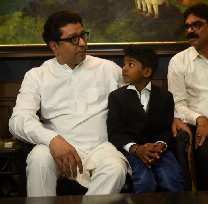 Loin kid Sunny Pawar with MNS chief Raj Thackarey.