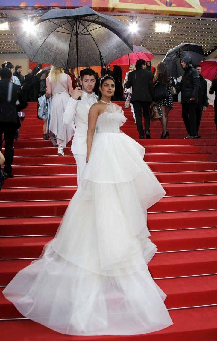 Nick Jonas holds the umbrella for Priyanka Chopra at Cannes Film Festival 2019 red carpet.