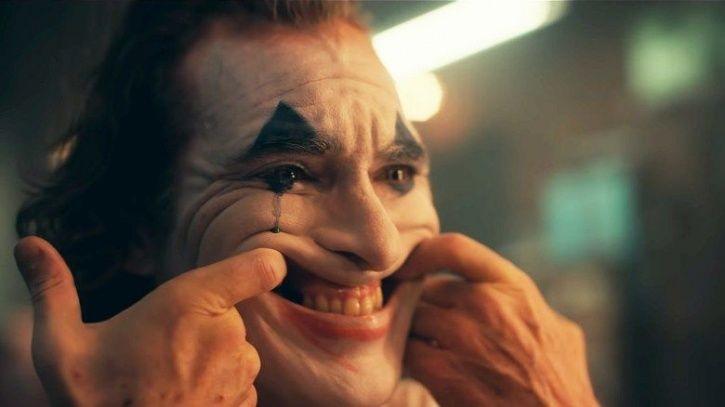 Resultado de imagem para joker forcing smile