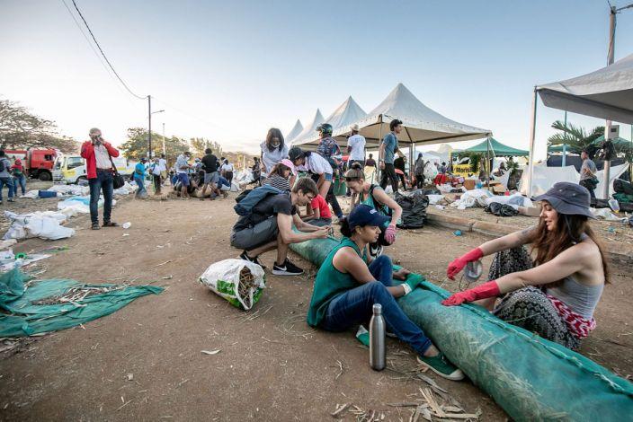 Volunteers make handmade oil barriers