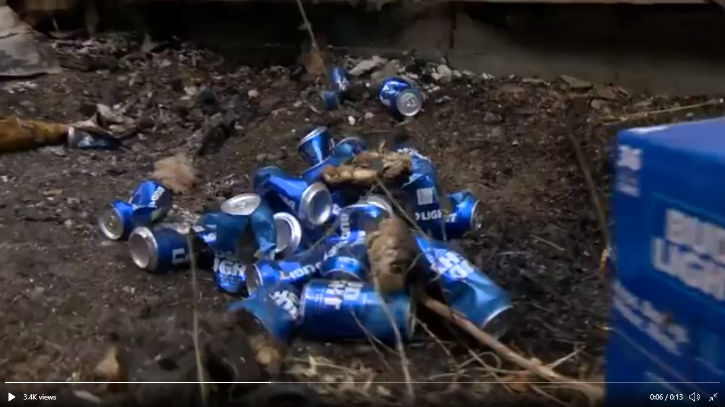 man uses Bud Light to put out fire