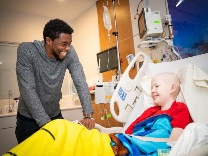 Chadwick Boseman with cancer patient.