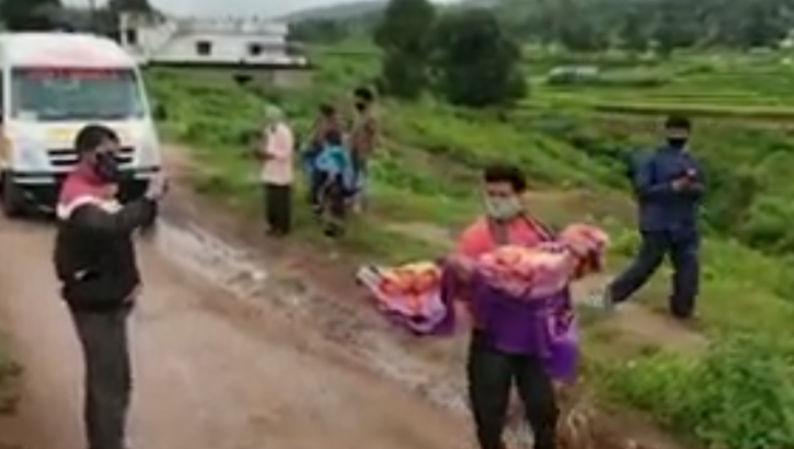 Man carrying body of dead daughter