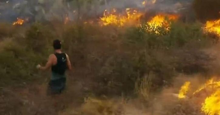 Jogger Tries To Put Out Fire With Tennis Shoes